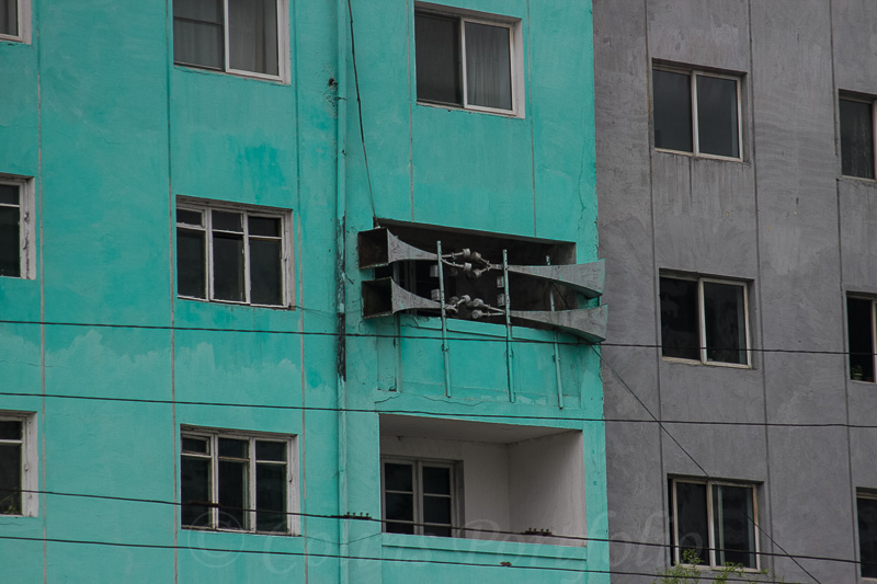 Loudspeakers on city apartment walls.