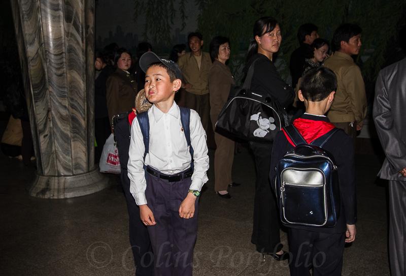 Some school children abount to take the metro.