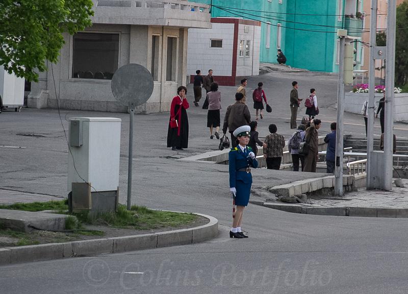 A traffic police officer, close to a pedestrian under-pass