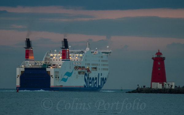 "The M.V. ""Stena Adventurer"" passing the Poolbeg lighthouse at dusk"