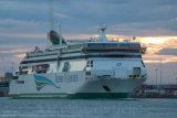 """Irish Ferries M.V. """"Ulysses"""" leaving Dublin Port at dusk"""