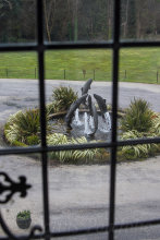 Salmon fountain sculpture, taken from within Lough Eske Castle