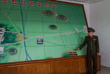 Graphic layout of the DMZ, being demonstrated by a soldier from the DPRK