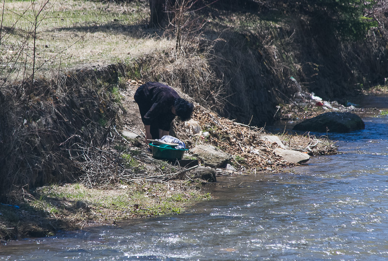 Washing clothes downstream