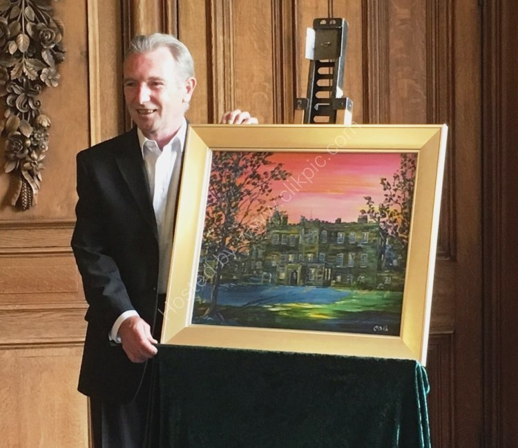 Colm with his painting of Newbattle Abbey College after it was unveiled.