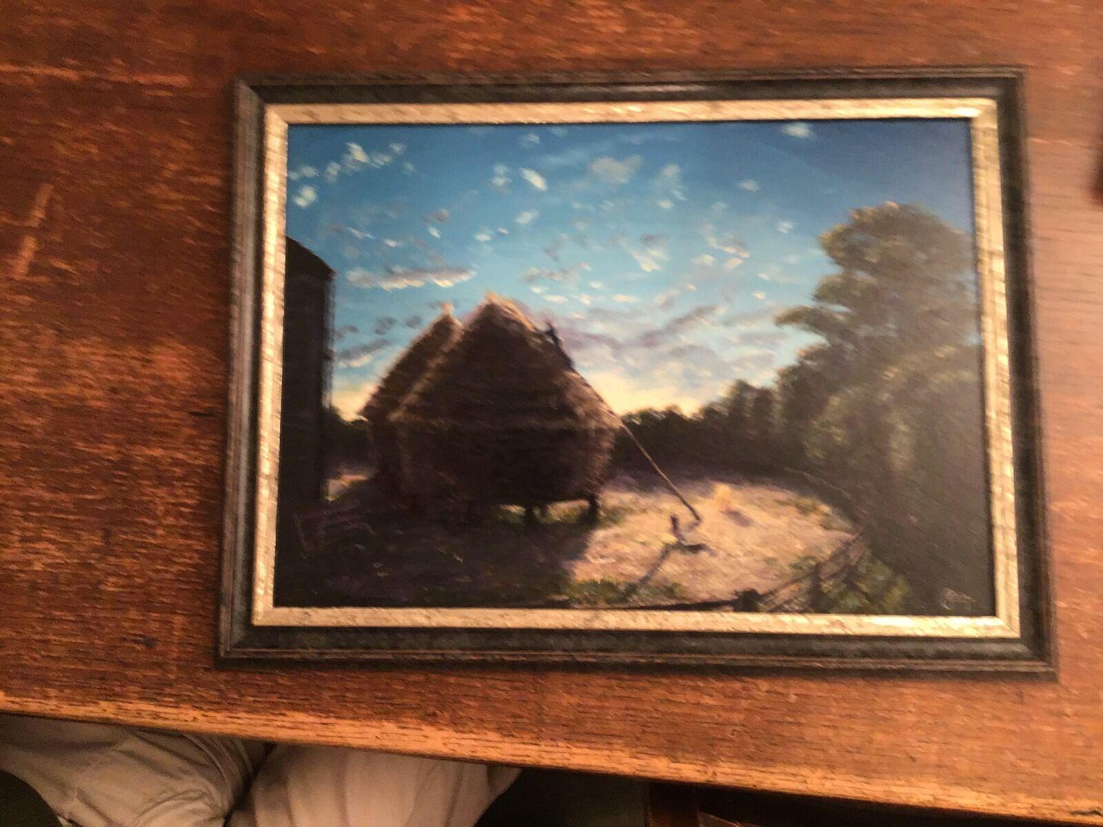 rick thatching at dusk framed