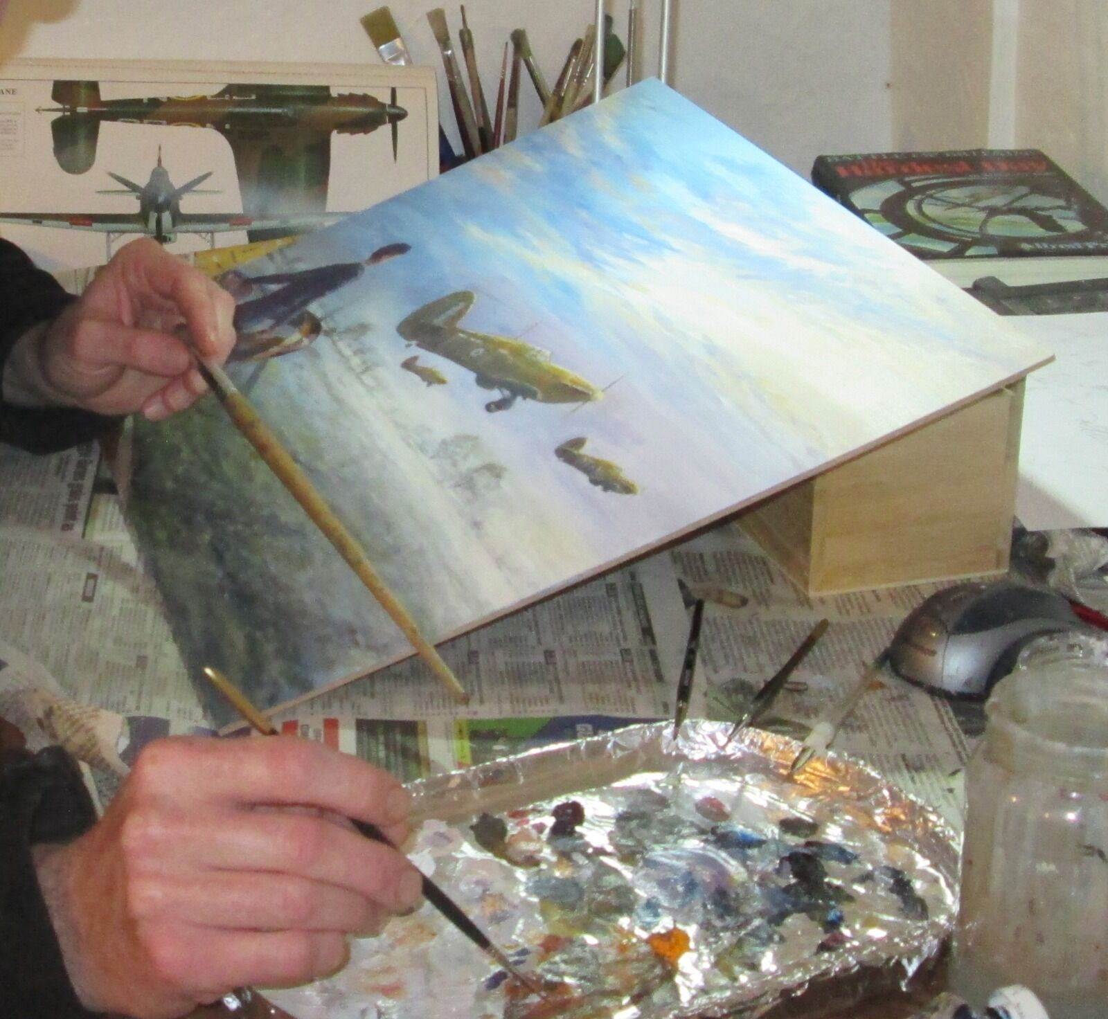 My improvised mahlstick in use on my Hurricane painting featuring Sgt. A. G. Girdwood's aircraft.