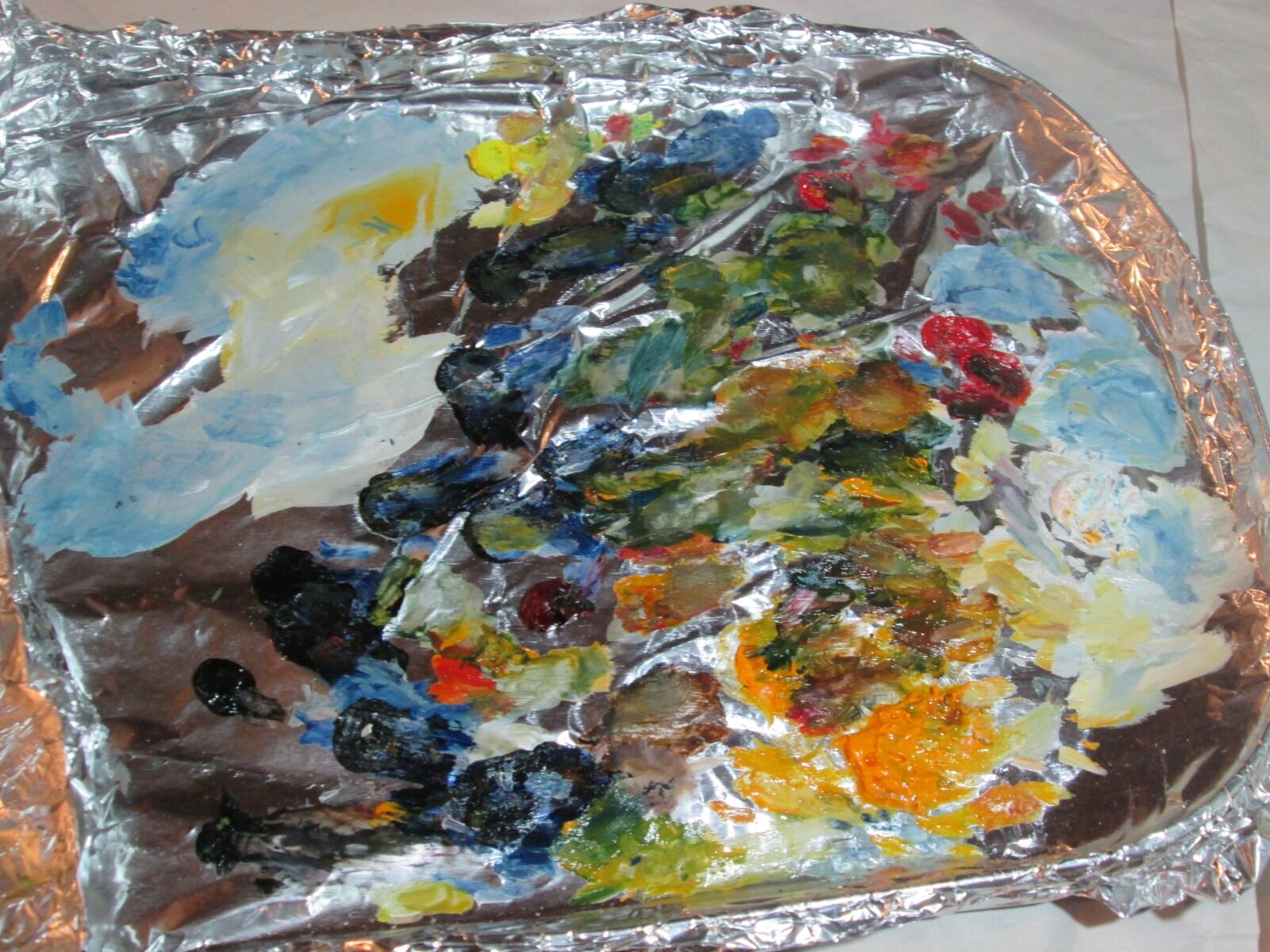 My pallete showing the complex mixes of colour that come from a very simple set of primaries
