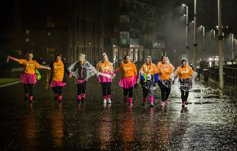Charity walkers in the rain by Ade Gidney - 2nd 19pts