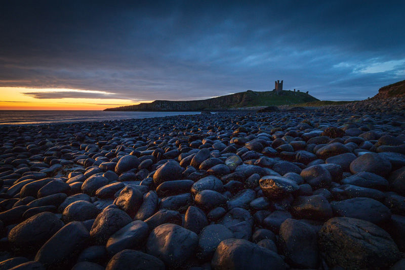 Dunstanburgh rocks by Adrian Gidney - Highly Commended