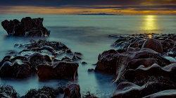 Sun setting at Fleswick Bay by Alan Wilson [17]