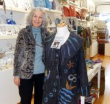 textile artist suzie sullivan wi her coat which has just won a major award from the Craft Council of Ireland