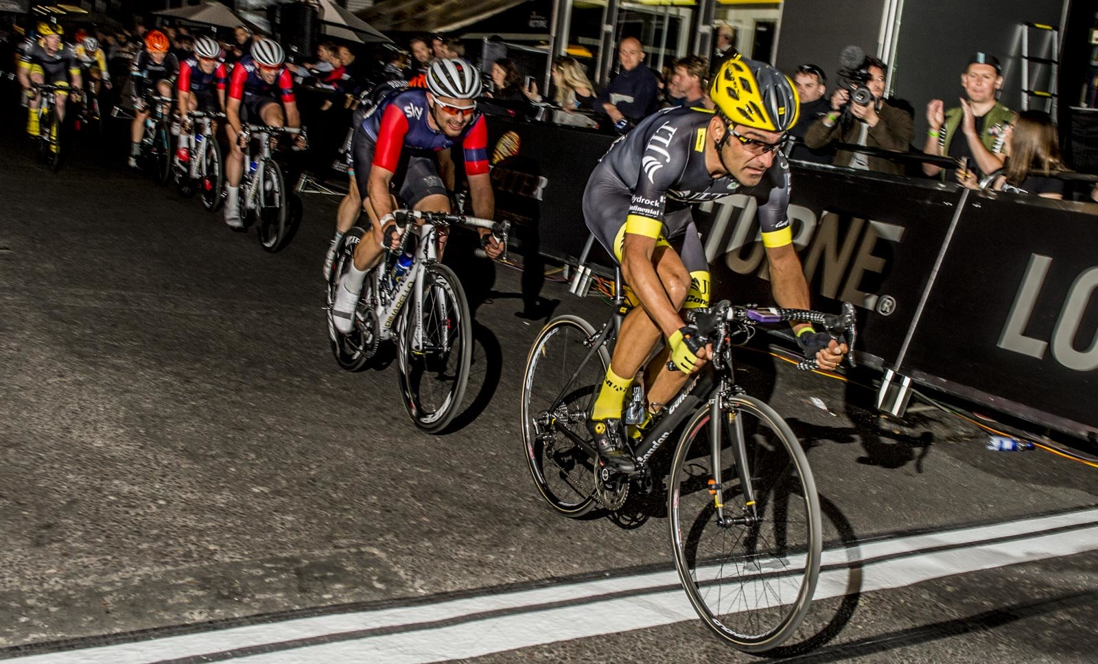 Kristian House leads the pack over the line