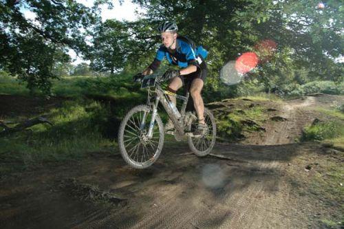 Mountain Mayhem Elite Rider catching air