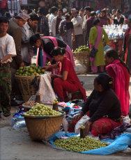 Seated fruit sellers