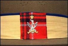 Queen's Gurkha Signals cap badge.