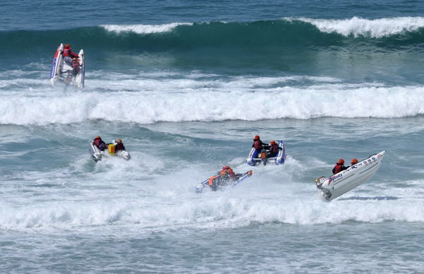 ZapCat racers fly the Watergate surf.