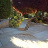 Smart walls and a sandstone terrace with curving steps