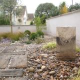 Shingles and pebbles in an elegant grey and white themed garden