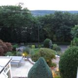 The terrace and gardens in the evening