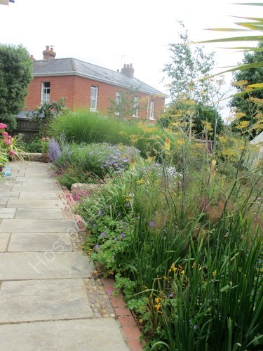 Arts and Crafts detailing in Yorkstone and brick paths