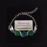 Chrysocolla gemstones in silver wire.