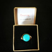 Turquoise gemstone wrapped in non tarnish antique bronze wire.