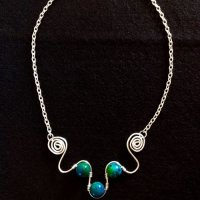 Chrysocolla gemstones in silver wire
