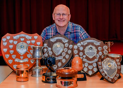 Ray Girling with his collection of trophies from this season