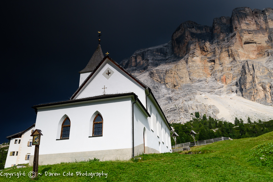 Storm Approaching - Sun on Church in the Dolomites