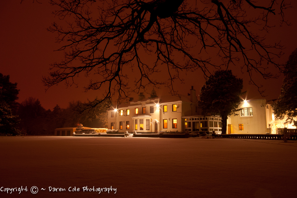 Manor House at Night in the Snow