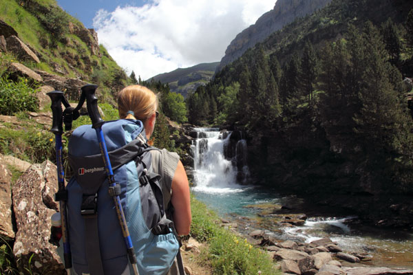 01D-6051 Female Hill Walker on the GR11 Footpath Enjoying the View of a Cascade on the Rio Arazas in the Ordesa Canyon, Pyrenees Spain