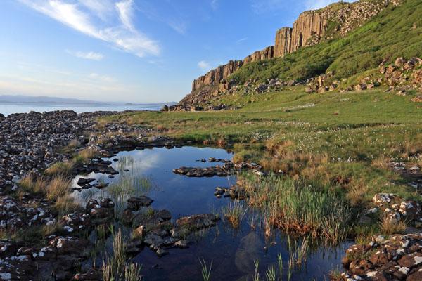 02D-0361 Pool and Cotton Grass eriophorum angustifolium and the View Over Staffin Bay Trotternish Peninsula Isle of Skye Scotland UK