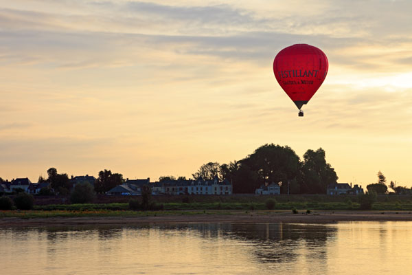02D-5663 Hot Air Balloon Flying Over the Town of Les Rosiers Sur Loire Just After Sunrise With the Loire River in the Foreground France
