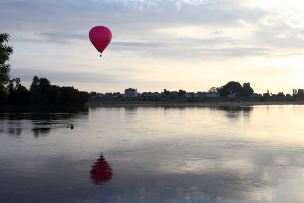 02D-5682 Hot Air Balloon Flying Over the Town of Les Rosiers Sur Loire Just After Sunrise With the Loire River in the Foreground France