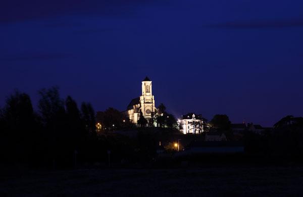 02D-6684 Eglise Saint Symphorien in the Small Town of Montjean Sur Loire at Night France.