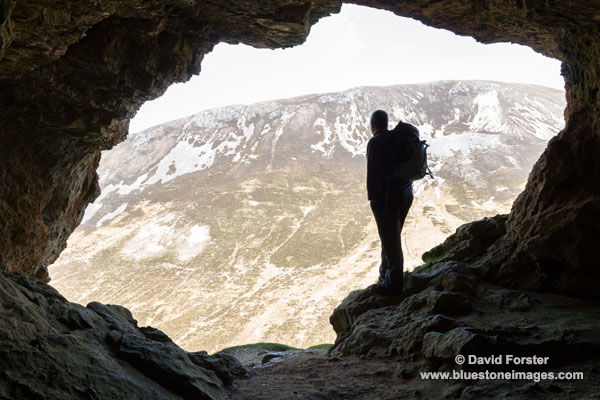02M-1244 Walker Looking Out of the The Inchnadamph Bone Caves Assynt Sutherland Scotland