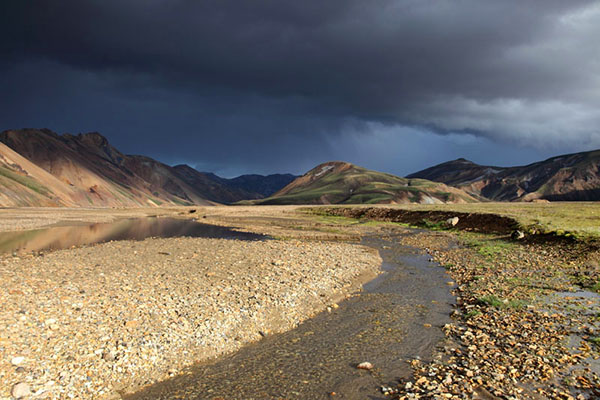 03D-4743 Storm Clouds over the Barmur Rhyolite Mountains Next to the River Jokulgilskvisl at Landmannalaugar in the Fjallabak Area of Iceland.