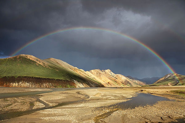 03D-4789a Rainbow over the Barmur Rhyolite Mountains and the River Jokulgilskvisl at Landmannalaugar in the Fjallabak Area of Iceland