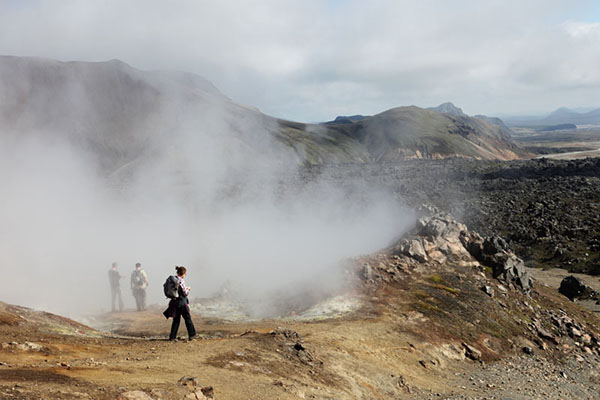 03D-4848 Hikers Walking through Clouds of Steam and Sulphur Gas from a Geothermal Volcanic Vent on the Laugavegur Hiking Trail Landmannalaugar Fjallabak Iceland.