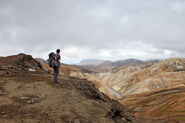 03D-5052 Trekker Enjoying the View Over the Colourful Ryolite Mountains on Day 2 of the Laugavegur Hiking Trail from Landmannalaugar to Thorsmork Fjallabak Area of Iceland