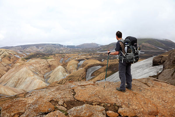 03D-5079 Trekker Enjoying the View Over the Colourful Ryolite Mountains on Day 2 of the Laugavegur Hiking Trail from Landmannalaugar to Thorsmork Fjallabak Area of Iceland.