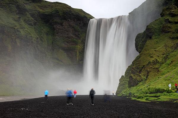 03D-5989 Tourists Below the 200ft (61m) High Skogafoss Waterfall Skogar Iceland