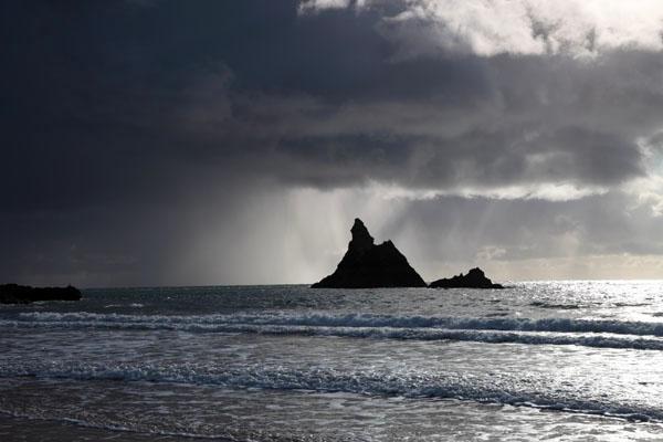 03D-9177 Storm Clouds Passing Behind Church Rock Broad Haven Beach Pembroke Pembrokeshire National Park Wales Cymru UK