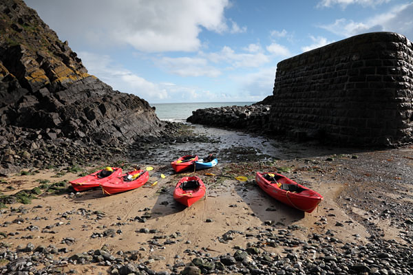 03D-9312 Canoes on the Beach at Stackpole Quay Pembrokeshire National Park Wales Cymru UK