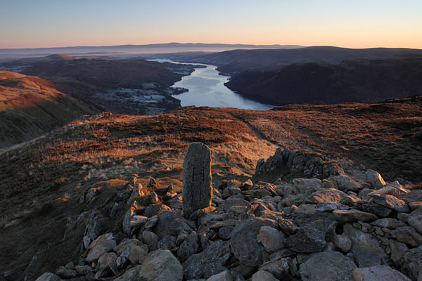 04D-0067 Boundary Stone on the Summit of Sheffield Pike at Dawn with Ullswater and the Distant Pennines, Lake District Cumbria UK