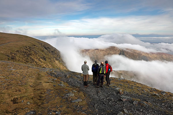 04D-0716 Four Walkers Watching Cloud Spill Over Sharp Edge on the Mountain of Blencathra Lake District Cumbria