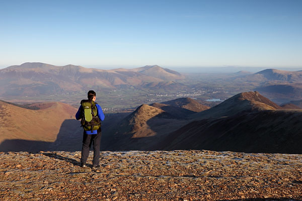 04D-2325 Hill Walker Looking Towards the Mountain of Causey Pike and the View NE Towards Skiddaw and Blencathra from the Summit of Crag Hill Lake District Cumbria UK
