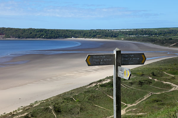 04D-8912 Coastal Footpath Sign to Nicholaston and Three Cliffs Bay With Oxwich Bay Behind Gower South Wales UK