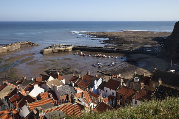 05D-5550 The Small Fishing Village of Staithes and its Harbour at Low Tide North Yorkshire UK.